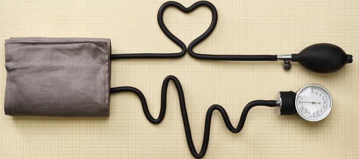 Sphygmomanometer with the tube shaped like a heart and wave.
